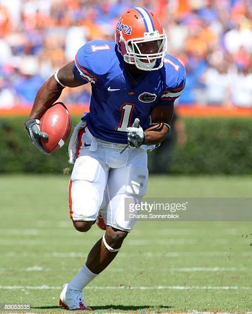 Running back Percy Harvin of the Florida Gators runs for a touchdown against the Mississippi Rebels during there game at Ben Hill Griffin Stadium on...