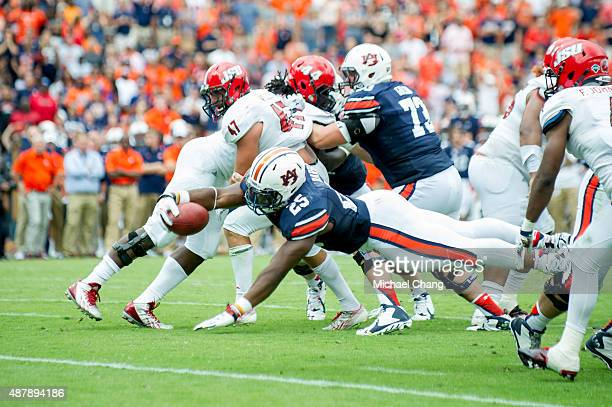 Running back Peyton Barber of the Auburn Tigers dives for the end zone during overtime in their game against the Jacksonville State Gamecocks on...