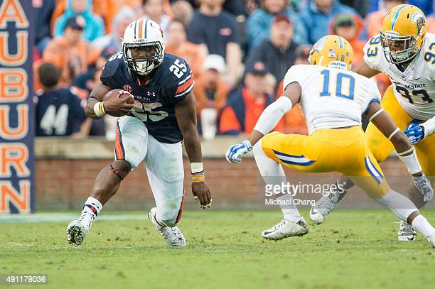 Running back Peyton Barber of the Auburn Tigers looks to maneuver by safety Maurice McKnight of the San Jose State Spartans on October 3 2015 at...
