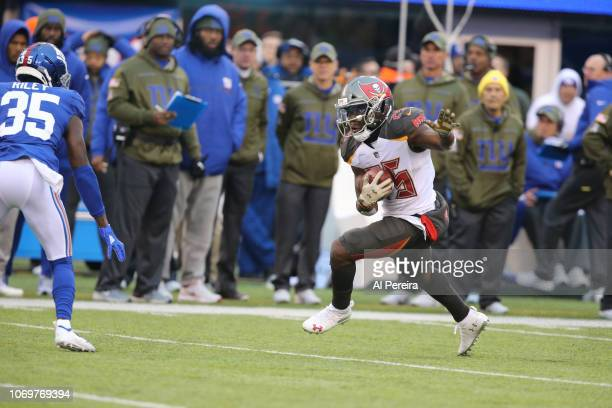 Running back Peyton Barber of the Tampa Bay Buccaneers carries the ball against the New York Giants at MetLife Stadium on November 18 2018 in East...