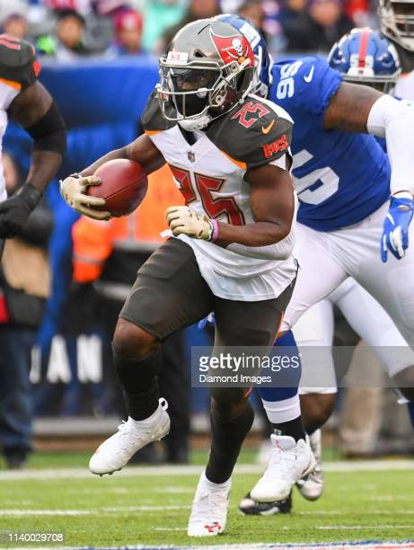 Running back Peyton Barber of the Tampa Bay Buccaneers carries the ball in the first quarter of a game against the New York Giants on November 18...