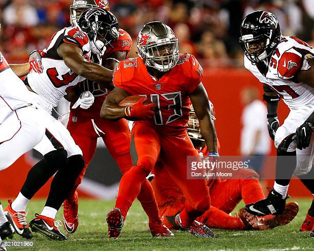 Running back Peyton Barber of the Tampa Bay Buccaneers on a running play during the game against the Atlanta Falcons at Raymond James Stadium on...