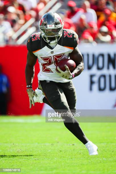 Running back Peyton Barber of the Tampa Bay Buccaneers picks up a first down on a 13yard run in the second quarter of the game between the Tampa Bay...