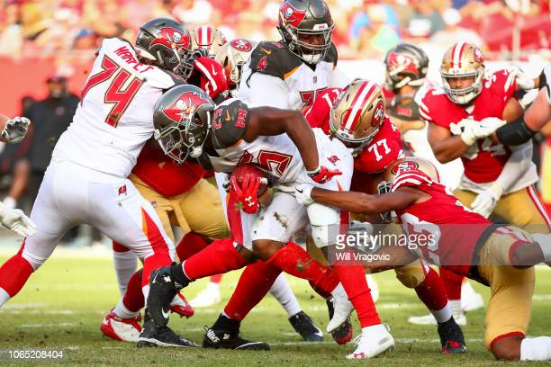 running back Peyton Barber of the Tampa Bay Buccaneers pushes up the middle for a gain of two in the fourth quarter of the game against the San...