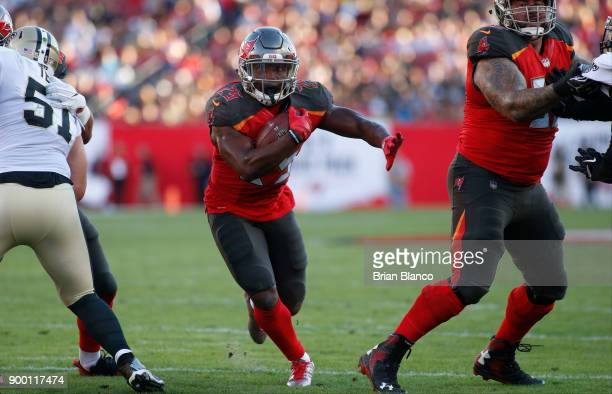 Running back Peyton Barber of the Tampa Bay Buccaneers runs the ball during the first quarter of an NFL football game against the New Orleans Saints...