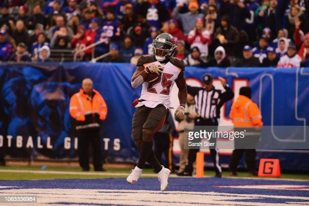 Running back Peyton Barber of the Tampa Bay Buccaneers scores a touchdown against the New York Giants during the fourth quarter at MetLife Stadium on...
