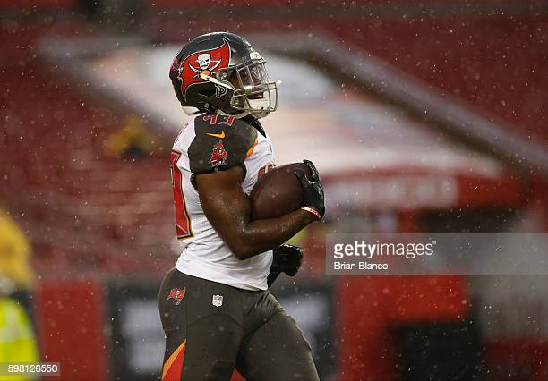 Running back Peyton Barber of the Tampa Bay Buccaneers warms up before the start of an NFL game against the Washington Redskins on August 31 2016 at...