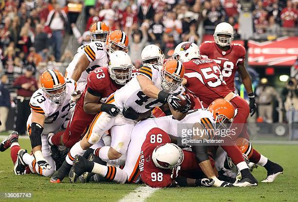 Runningback Peyton Hillis of the Cleveland Browns dives into the end zone to score on a 1 yard rushing touchdown against the Arizona Cardinals during...