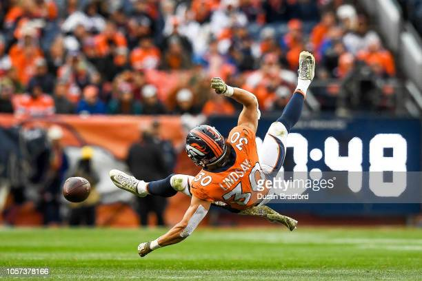 Running back Phillip Lindsay of the Denver Broncos at Broncos Stadium is upended after getting hit in the third quarter of a game against the Houston...
