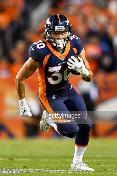 Running back Phillip Lindsay of the Denver Broncos carries the ball against the Kansas City Chiefs in the third quarter of a game at Broncos Stadium...