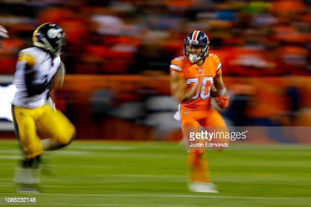 Running back Phillip Lindsay of the Denver Broncos carries the ball against the Pittsburgh Steelers in the third quarter of a game against the...