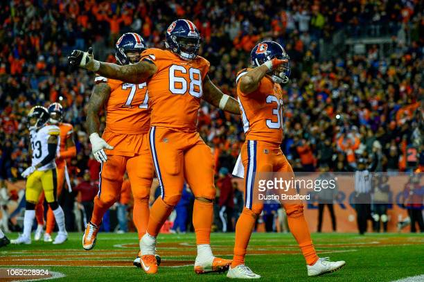 Running back Phillip Lindsay of the Denver Broncos celebrates after scoring a fourth quarter touchdown against the Pittsburgh Steelers at Broncos...