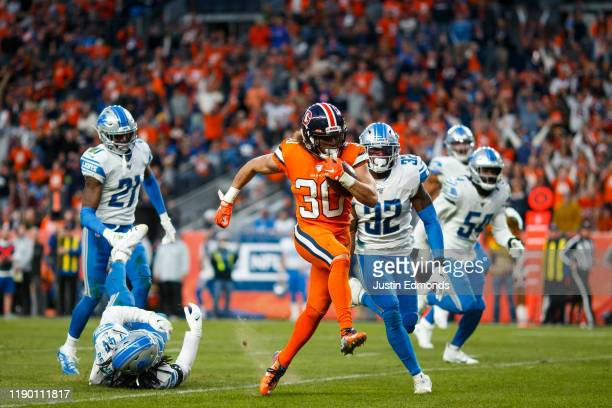 Running back Phillip Lindsay of the Denver Broncos runs for a touchdown during the fourth quarter against the Detroit Lions at Empower Field at Mile...