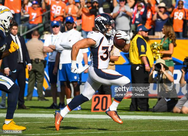 Running back Phillip Lindsay of the Denver Broncos runs the ball in for a touchdown in the second quarter against the Los Angeles Chargers at StubHub...
