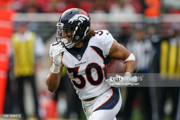 Running back Phillip Lindsay of the Denver Broncos runs the ball against the San Francisco 49ers at Levi's Stadium on December 9, 2018 in Santa...