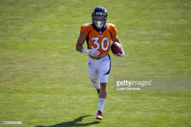 Running back Phillip Lindsay of the Denver Broncos runs with the football during a training session at UCHealth Training Center on August 17, 2020 in...