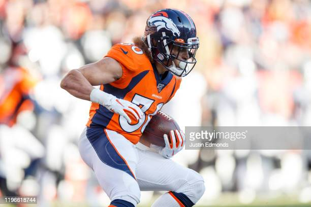 Running back Phillip Lindsay of the Denver Broncos runs with the football against the Oakland Raiders during the first quarter at Empower Field at...