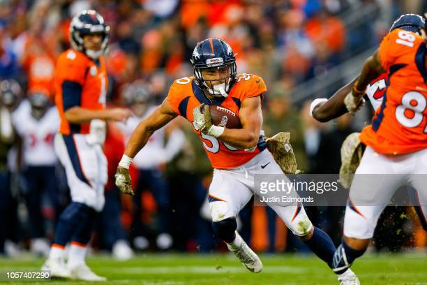 Running back Phillip Lindsay of the Denver Broncos rushes against the Houston Texans in the third quarter of a game at Broncos Stadium at Mile High...