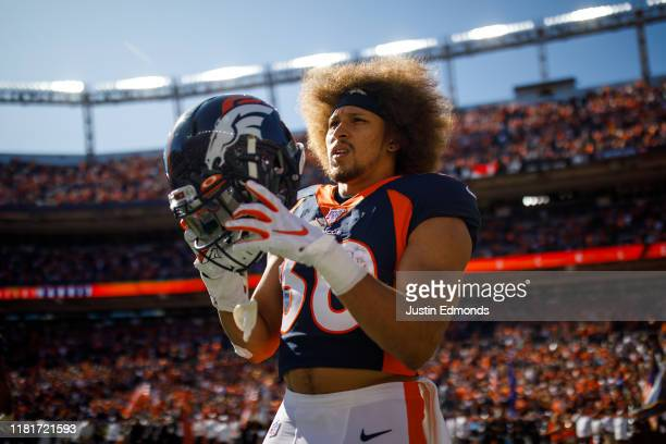Running back Phillip Lindsay of the Denver Broncos stands on the field before the game against the Tennessee Titans at Empower Field at Mile High on...