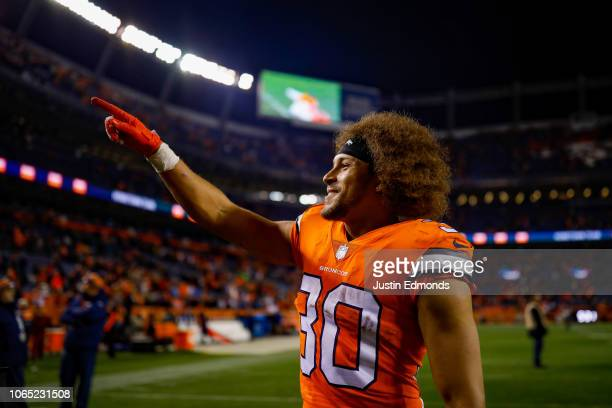 Running back Phillip Lindsay of the Denver Broncos walks off the field after a 24-17 win over the Pittsburgh Steelers at Broncos Stadium at Mile High...