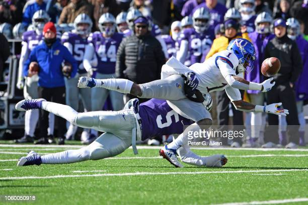 Running back Pooka Williams Jr #1 of the Kansas Jayhawks drops the pass after getting hit by linebacker Da'Quan Patton of the Kansas State Wildcats...