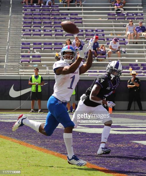 Running back Pooka Williams Jr #1 of the Kansas Jayhawks makes a touchdown reception in the fourth quarter against the TCU Horned Frogs at Amon G...