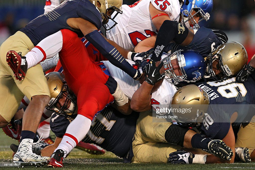 Running back Prescott Line #42 of the Southern Methodist Mustangs is tackled by defensive end Will Anthony #90 of the Navy Midshipmen and other defenders in the second quarter at Navy-Marine Corps Memorial Stadium on November 14, 2015 in Annapolis, Maryland.