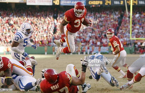 Running back Priest Holmes of the Kansas City Chiefs dives in the air to score a touchdown against the Indianapolis Colts in the AFC Divisional...