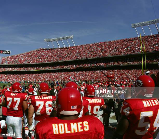 Running back Priest Holmes of the Kansas City Chiefs takes the field with teammates before the game with the Houston Texans at Arrowhead Stadium on...