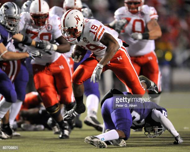 Running back Quentin Castille of the Nebraska Cornhuskers runs over the top of defensive back Jase Hartenbower of the Kansas State Wildcats enroute...