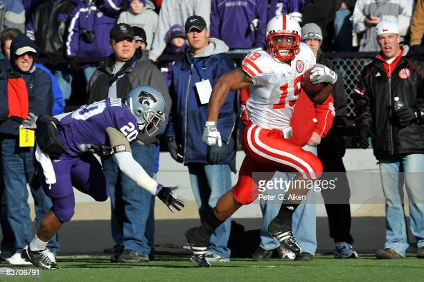 Running back Quentin Castille of the Nebraska Cornhuskers rushes past defensive back Courtney Herndon of the Kansas State Wildcats enroute to a...