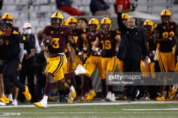 Running back Rachaad White of the Arizona State Sun Devils carries the football for a 93-yard rushing touchdown against the Arizona Wildcats during...
