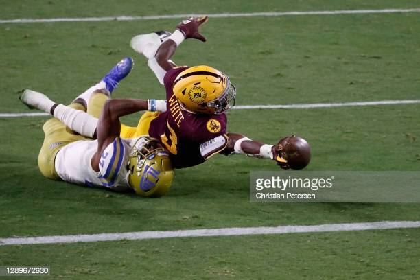 Running back Rachaad White of the Arizona State Sun Devils is tackled by defensive back Quentin Lake of the UCLA Bruins on a failed 2-point...