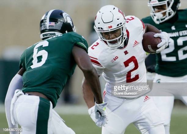 Running back Raheem Blackshear of the Rutgers Scarlet Knights rushes against safety David Dowell of the Michigan State Spartans at Spartan Stadium on...