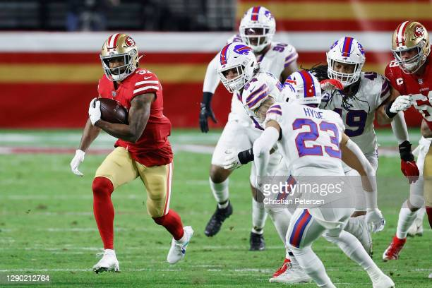 Running back Raheem Mostert of the San Francisco 49ers rushes the football against strong safety Micah Hyde of the Buffalo Bills during the NFL game...