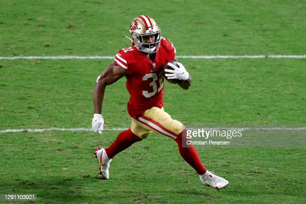 Running back Raheem Mostert of the San Francisco 49ers rushes the football against the Washington Football Team in the third quarter of the game at...
