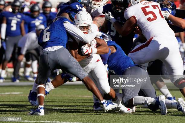 running back Rakeem Boyd of the Arkansas Razorbacks is tackled by defensive back Edwyn Brown of the Eastern Illinois Panthers during the Arkansas...