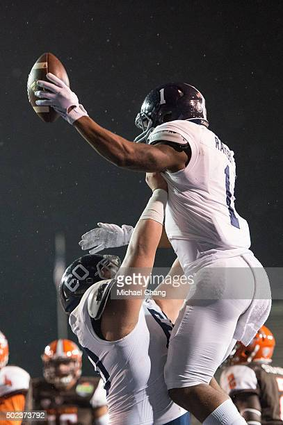 Running back LA Ramsby of the Georgia Southern Eagles celebrates with offensive lineman Andy Kwon of the Georgia Southern Eagles after scoring a...