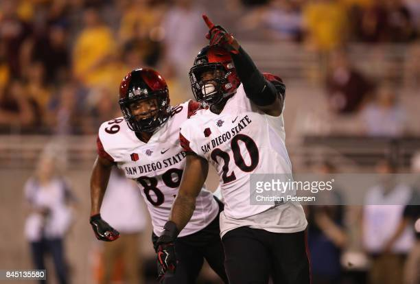 Running back Rashaad Penny of the San Diego State Aztecs celebrates alongside Fred Trevillion after scoring on a 33 yard touchdown reception against...