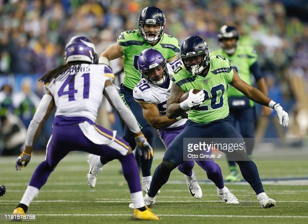 Running back Rashaad Penny of the Seattle Seahawks carries the ball against the defense of the Minnesota Vikings at CenturyLink Field on December 02,...