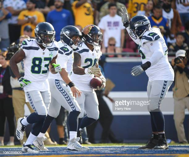 Running back Rashaad Penny of the Seattle Seahawks celebrates his touchdown with quarterback Russell Wilson to take a 147 lead in the first quarter...