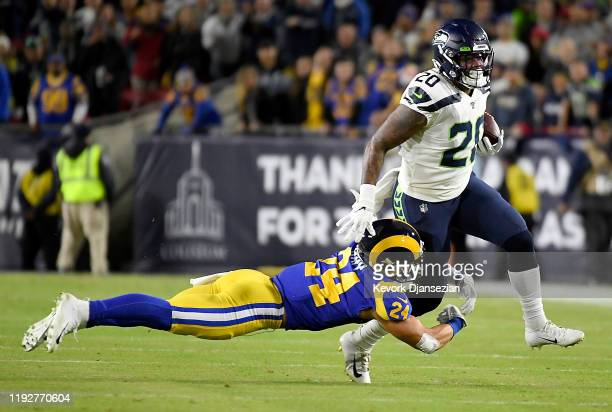 Running back Rashaad Penny of the Seattle Seahawks is tackled by safety Taylor Rapp of the Los Angeles Rams in the first quarter of the game at Los...