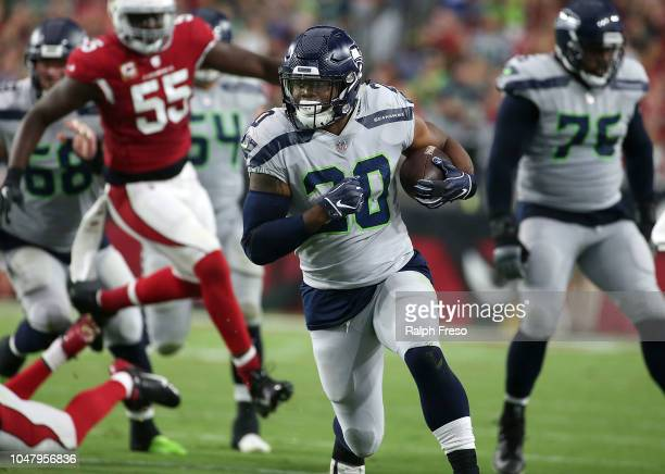 Running back Rashaad Penny of the Seattle Seahawks runs with the ball during an NFL game against the Arizona Cardinals at State Farm Stadium on...