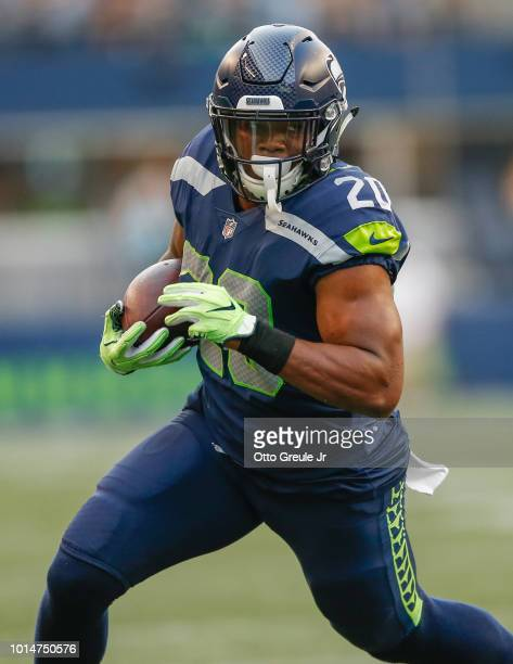 Running back Rashaad Penny of the Seattle Seahawks rushes against the Indianapolis Colts at CenturyLink Field on August 9 2018 in Seattle Washington