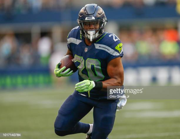Running back Rashaad Penny of the Seattle Seahawks rushes against the Indianapolis Colts at CenturyLink Field on August 9, 2018 in Seattle,...