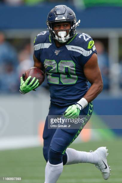 Running back Rashaad Penny of the Seattle Seahawks rushes against the Cincinnati Bengals at CenturyLink Field on September 8, 2019 in Seattle,...