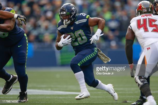 Running back Rashaad Penny of the Seattle Seahawks rushes against the Tampa Bay Buccaneers at CenturyLink Field on November 3, 2019 in Seattle,...