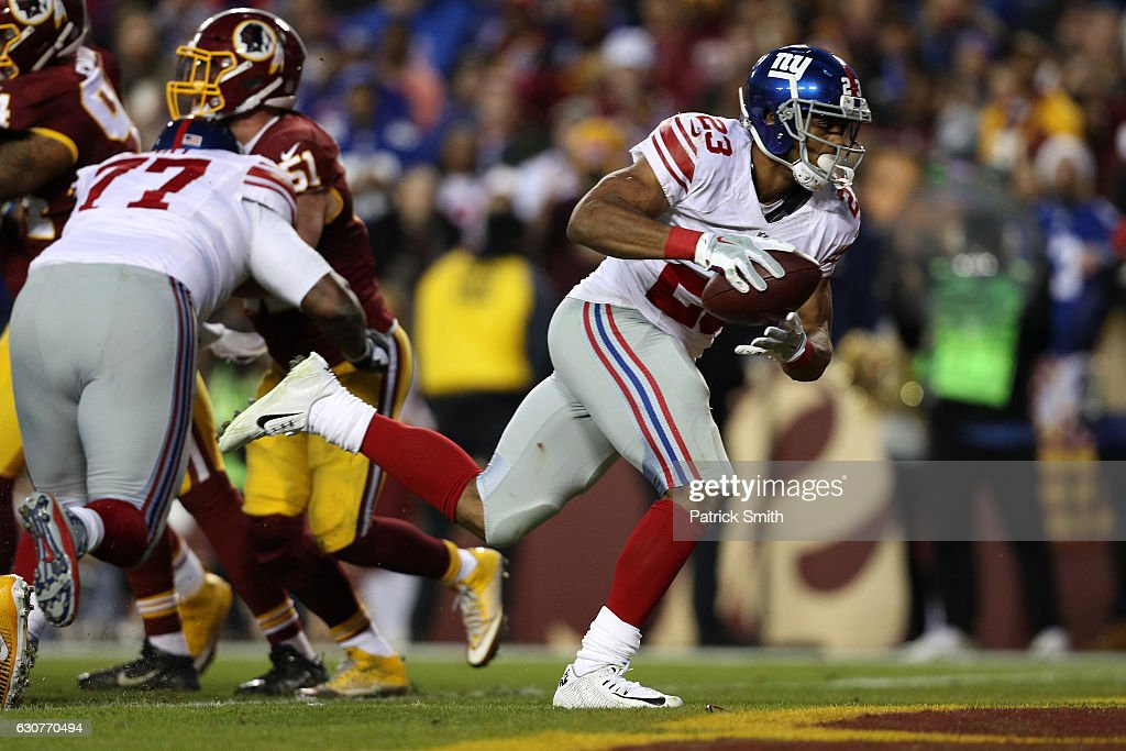 Running back Rashad Jennings #23 of the New York Giants scores a second quarter touchdown while teammate guard John Jerry #77 blocks against inside linebacker Will Compton #51 of the Washington Redskins at FedExField on January 1, 2017 in Landover, Maryland.