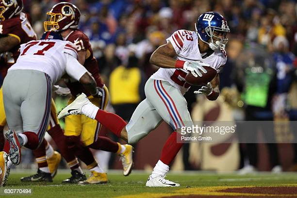 Running back Rashad Jennings of the New York Giants scores a second quarter touchdown while teammate guard John Jerry blocks against inside...