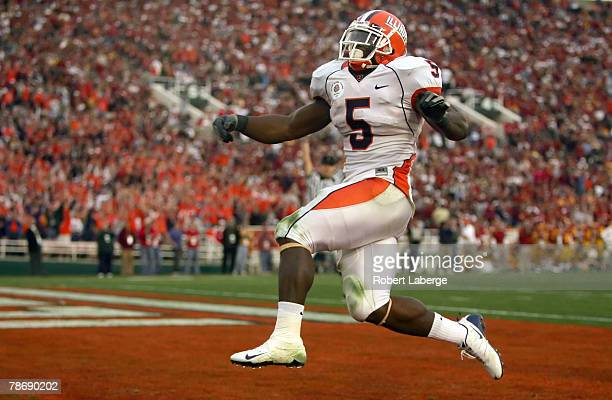 Running back Rashard Mendenhall of the Illinois Fighting Illini celebrates after scoring the Illini's first touchdown in the third quarter over the...